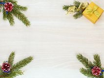 Christmas background with fir tree branches, cones and gift box Royalty Free Stock Photos