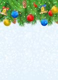Christmas background with fir tree branches, pine cone, bell, bow and red, blue, yellow balls Royalty Free Stock Photography
