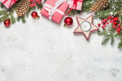 Christmas background with fir tree, candle and decorations on wh stock images
