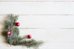 Christmas background fir tree and christmas decorations on wooden table with copy space. Top view Stock Photos
