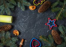 Christmas background with fir tree and cones, candle. Top view with copy space Stock Image