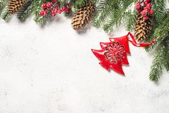 Christmas background with fir tree and cones on white backgroun stock photo