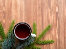 Christmas background with fir tree and cup of tea Royalty Free Stock Photos