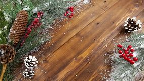 Christmas wooden background with snow branch. Top view with copy space for your text stock video footage