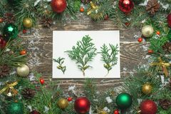 Christmas background with fir tree and decoration on dark wooden board stock image