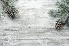 Christmas background with fir tree and decoration on dark wooden board. Christmas, New Year`s composition. Stock Photo