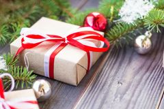 Christmas background with fir tree and decorations and gift boxes on wooden board Stock Image