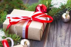 Christmas background with fir tree and decorations and gift boxes on wooden board Stock Photo