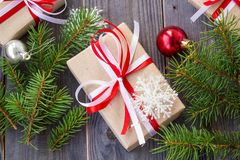 Christmas background with fir tree and decorations and gift boxes on wooden board Royalty Free Stock Photo