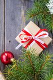 Christmas background with fir tree and decorations and gift boxes on wooden board Royalty Free Stock Image