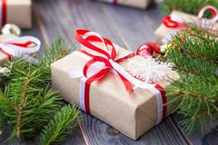 Christmas background with fir tree and decorations and gift boxes on wooden board Stock Photos