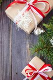 Christmas background with fir tree and decorations and gift boxes on wooden board Stock Photography