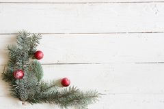 Christmas background fir tree and christmas decorations on wooden table with copy space. Top view Stock Image