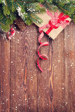 Christmas background with fir tree and gift box Royalty Free Stock Image