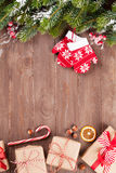 Christmas background with fir tree and gift boxes Stock Images