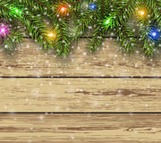 Christmas background fir tree on wooden board Stock Photos