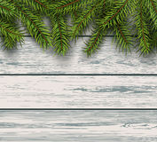 Christmas background fir tree on wooden board Royalty Free Stock Photo