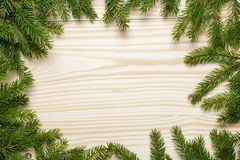 Christmas background from fir twigs on wooden table royalty free stock image