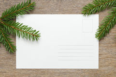 Christmas background from fir twigs on wooden table Stock Photo
