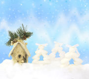 Christmas background with firs, house and lights Royalty Free Stock Image