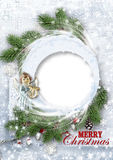 Christmas background with firtree and angel. Christmas tenderness background with snowy branches and Christmas decorations with space for greetings and photos Stock Photography