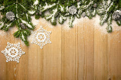 Christmas background with firtree, decorative snowlakes and cone Stock Photography