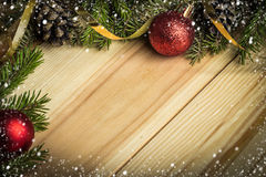 Christmas background with  firtree  on wood with  snow Stock Images