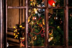 Christmas background with flashing candles garland on the tree Stock Photos