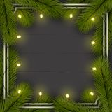 Christmas background. Frame of Christmas tree branches. With a garland of lights. Eps 10 Stock Images