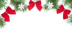 Christmas background. Frame decorated with snowflakes and red bows isolated on white with copy space for your text. Top view Royalty Free Stock Image