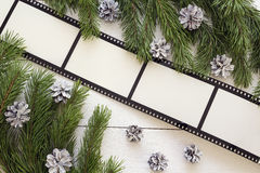 Christmas background with frame in the form of a film, fir branc Stock Photo