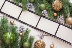 Christmas background with frame in the form of a film, fir branc Royalty Free Stock Photos