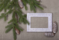 Christmas background with frame and spruce branches on the canva Royalty Free Stock Photography