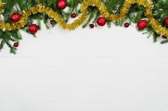 Christmas background frame top view on white with copy space. Christmas background frame top view on white wooden plank table background with copy space around royalty free stock photos