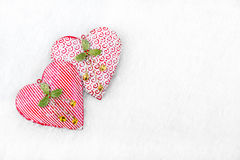 Christmas Background - Frozen hearts in the snow Royalty Free Stock Photography
