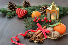Christmas background with fruits, spices, fir, candle and decorations Royalty Free Stock Image
