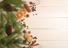 Christmas background with fur-tree branches, cones, dried orange Royalty Free Stock Images