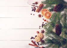 Christmas background with fur-tree branches, cones, dried orange Stock Image