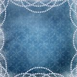 Christmas background with a garland of beads on the edge on a blue. Christmas greeting background with a garland of beads around the edge and snow Stock Photography