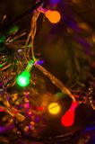 Christmas background-garlands with colorful lights on a decorated Christmas tree, bokeh royalty free stock photos