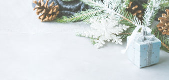 Christmas background with gift and baubles. Banner. Christmas winter gray background with fir tree branches, pine cones, baubles and snow. New year greeting card Royalty Free Stock Image