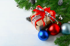 Christmas background with gift box, blue and red ornaments Stock Photography