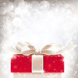 Christmas background with gift. Gift box with a bow on a Christmas background with snowflakes Stock Images
