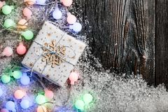 Christmas background with gift box and colorful light Royalty Free Stock Photography