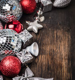 Christmas background with gift box, mirror balls and bow Royalty Free Stock Photo
