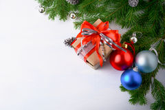 Christmas background with gift box and multicolored ornaments Royalty Free Stock Images