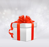 Christmas background with gift box with red bow. Stock Images