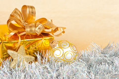 Christmas background with a gift box and a tinsel Stock Photo