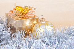 Christmas background with a gift box and a tinsel Royalty Free Stock Photo