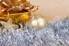 Christmas background with a gift box and a tinsel Royalty Free Stock Photography
